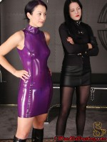 A hardcore ballbusting done by a couple tall Brunette Dominatrixes